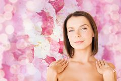 Beautiful woman touching her shoulders Stock Images