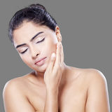 Beautiful woman touching her skin face Royalty Free Stock Photography