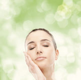 Beautiful woman touching her smooth skin Stock Image