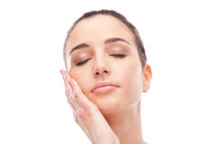 Beautiful woman touching her smooth skin Stock Photo