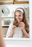 Beautiful woman touching her well-groomed hair Royalty Free Stock Images