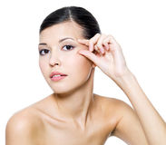 Beautiful woman touching skin around the eyes Royalty Free Stock Photo
