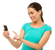 Beautiful Woman Touching Smart Phone Over White Background Stock Photography