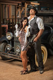 Beautiful Woman with Tough Gangster. Beautiful women in mini skirt with tough armed gangster Stock Photography