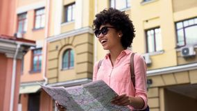 Beautiful woman tourist looking map, searching for city sightseeing places. Stock photo royalty free stock images