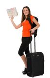 A beautiful woman tourist with a map in hand luggage isolated on Royalty Free Stock Image