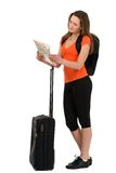 A beautiful woman tourist with a map in hand luggage isolated on Royalty Free Stock Images