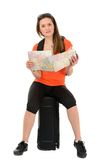 A beautiful woman tourist with a map in hand luggage isolated on Royalty Free Stock Photos