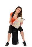 A beautiful woman tourist with a map in hand luggage isolated on Royalty Free Stock Photo