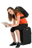 A beautiful woman tourist with a map in hand luggage isolated on Stock Photos