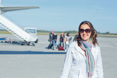 Beautiful woman tourist prepared to fly Royalty Free Stock Images