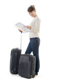Beautiful woman tourist with suitcases and map Stock Photography