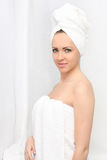 Beautiful woman with towel. On a white background Royalty Free Stock Image