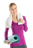 Beautiful Woman With Towel And Exercise Mat Stock Photography