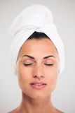 Beautiful woman with towel on head stock image