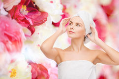 Beautiful woman in towel Stock Photos