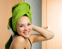 Beautiful woman with a towel on her head stock image