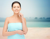 Beautiful woman in towel over infinity pool Stock Images