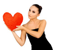 Beautiful woman with toy heart. Stock Images