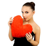 Beautiful woman with toy heart. Royalty Free Stock Photography