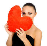 Beautiful woman with toy heart. Stock Image