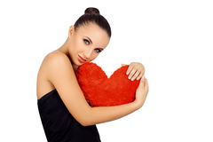 Beautiful woman with toy heart. Royalty Free Stock Image