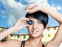 Beautiful woman with toy small camera Royalty Free Stock Images