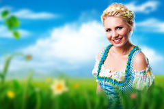 Beautiful woman in traditional bavarian dirndl. Beautiful woman in a traditional bavarian dirndl stock photography