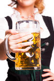 Beautiful woman in a traditional bavarian dirndl with a beer Royalty Free Stock Photos
