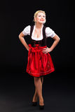 Beautiful woman in traditional bavarian dirndl. Beautiful woman in a traditional bavarian dirndl on black background royalty free stock image