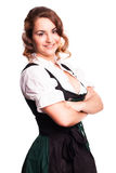 Beautiful woman in a traditional bavarian dirndl. Isolated on white royalty free stock photography