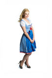 Beautiful woman in a traditional bavarian dirndl. Isolated on white stock photography