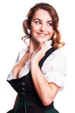 Beautiful woman in a traditional bavarian dirndl. Isolated on white stock image