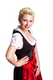Beautiful woman in traditional bavarian dirndl. Beautiful woman in a traditional bavarian dirndl isolated on white stock photography