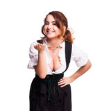Beautiful woman in a traditional bavarian dirndl. Isolated on white stock images