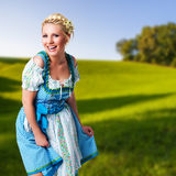 Beautiful woman in a traditional bavarian dirndl. Beautiful smiling woman in a traditional bavarian dirndl stock image