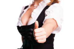 Beautiful woman in a  traditional bavarian dirndl with thumb up gesture Royalty Free Stock Photo
