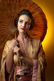 Beautiful woman in traditional japanese kimono with umbrella Royalty Free Stock Image