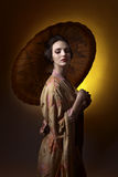 Beautiful woman in traditional japanese kimono with umbrella Stock Photo