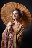 Beautiful woman in traditional Japanese kimono with umbrella Stock Images