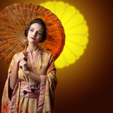 Beautiful woman in traditional japanese kimono with umbrella Royalty Free Stock Photos