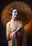 Beautiful woman in traditional japanese kimono with umbrella Stock Photos