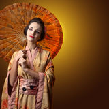 Beautiful woman in traditional japanese kimono with umbrella Royalty Free Stock Photo