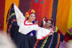 Beautiful woman in traditional Latino costume. Portland, OR / USA - May 7 2016: Beautiful woman in a traditional latino costume dancing at the cinco de mayo