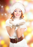A beautiful woman in traditional winter clothes Royalty Free Stock Photography