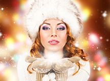 A beautiful woman in a traditional winter dress Royalty Free Stock Photography