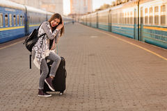 Beautiful woman at the train station Stock Photos