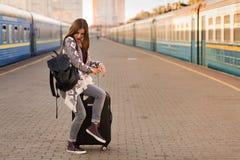Beautiful woman at the train station. Beautiful woman waiting at the train station stock images