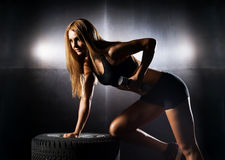 Beautiful woman training with dumbbells in the gym Stock Photos