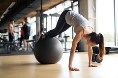 Beautiful woman training in gym. Beautiful women training pilates in gym Royalty Free Stock Images